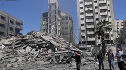 People inspected the rubble of a destroyed residential building that was hit by an Israeli airstrike, in Gaza City, on Sunday.