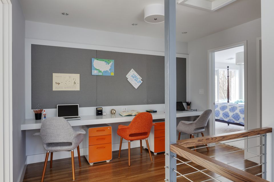 The second-floor landing was converted into a study space for the homeowner's three children.