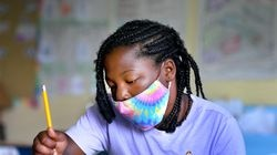 Third-grader Miyasha Young wears a mask during summer school at the Horace Mann School in Salem in this August file photo.