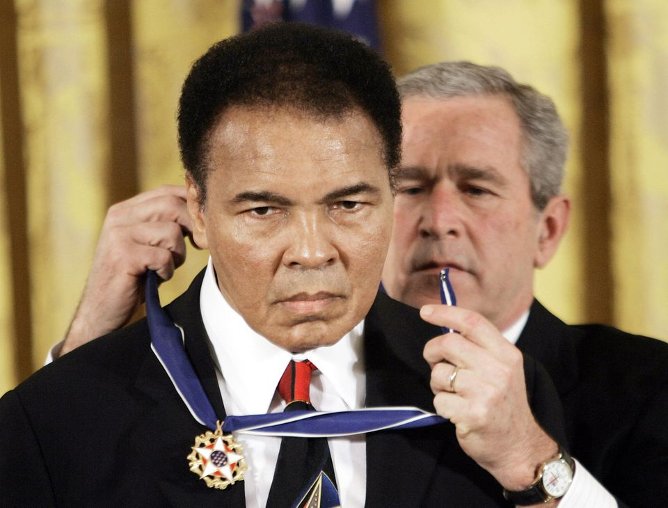 President Bush presented the Presidential Medal of Freedom to boxer Muhammad Ali.