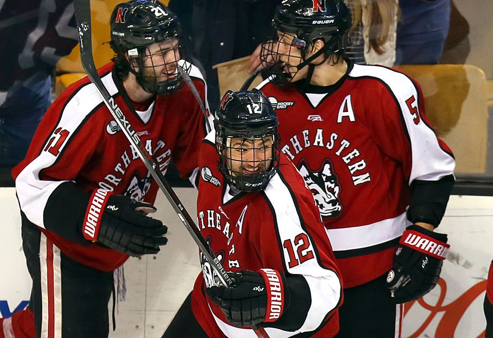 Northeastern's Zach Aston-Reese (13) celebrated his third-period goal.