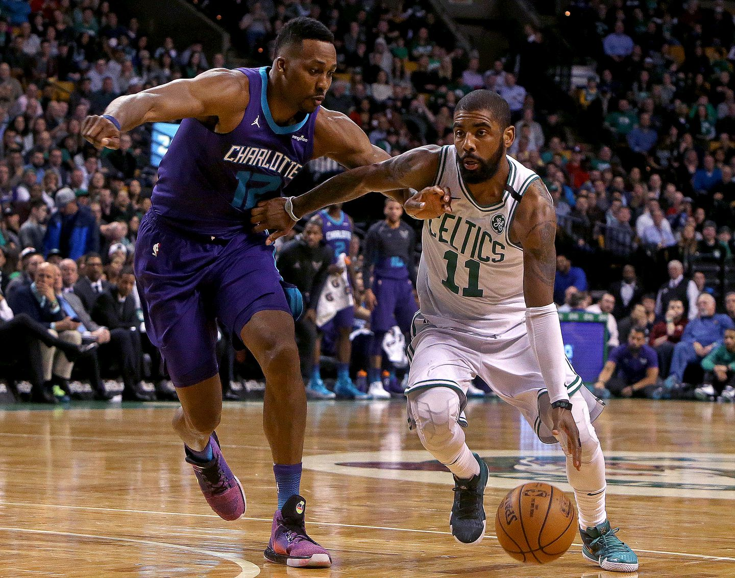 ccb193df1e4b Celtics guard Kyrie Irving (11) drives past Charlotte s Dwight Howard (12)  in