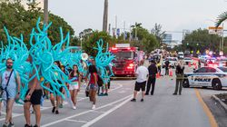Parade participants walked away as police investigated the scene where a pickup truck drove into a crowd of people at a Pride parade on June 19, 2021 in Wilton Manors, Florida.