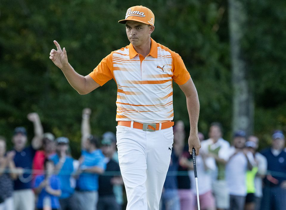 Rickie Fowler reacts after sinking a long birdie putt on the 14th hole in the final round of the Deutsche Bank Monday.