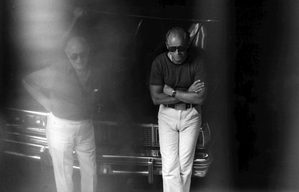 "A 1980 surveillance photo shows James ""Whitey"" Bulger, right, and another man at a Lancaster Street garage in Boston's North End."