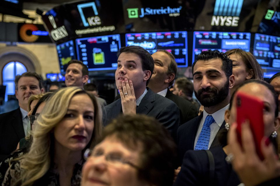 People on the floor of the New York Stock Exchange moments before the closing bell.