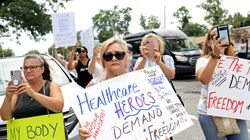 Demonstrators gathered for an anti-vaccine-mandate protest in front of the Staten Island University Hospital in Aug. 16, 2021. Monday is the COVID-19 vaccination deadline for New York State health care workers. Thousands of refusers have failed to meet it.