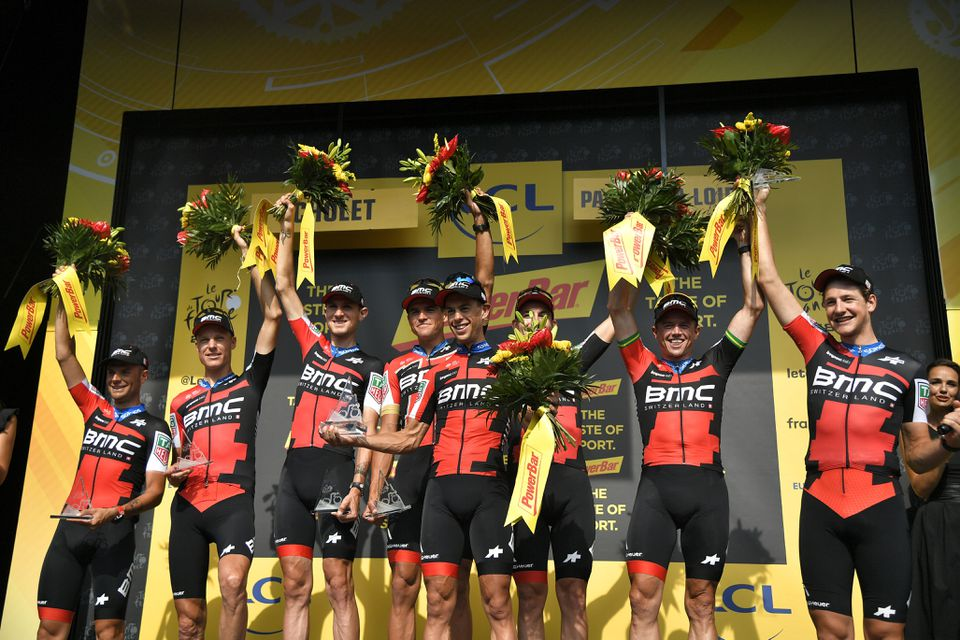 Australia's Richie Porte (center) and his teammates on USA's BMCteam celebrate on the podium after winning the third stage of the Tour de France.