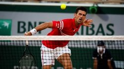 Novak Djokovic returns a shot to Rafael Nadal during their four-hour semifinal match at the French Open in Paris.