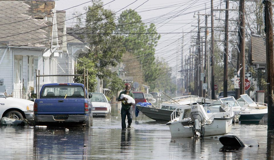 A man waded in the 7th Ward of New Orleans on Sept. 4, 2005.