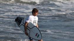 Italy's Leonardo Fioravanti makes his way into the water for surfing's Olympic debut, at Tsurigasaki Surfing Beach in Ichinomiya, Chiba, Japan.