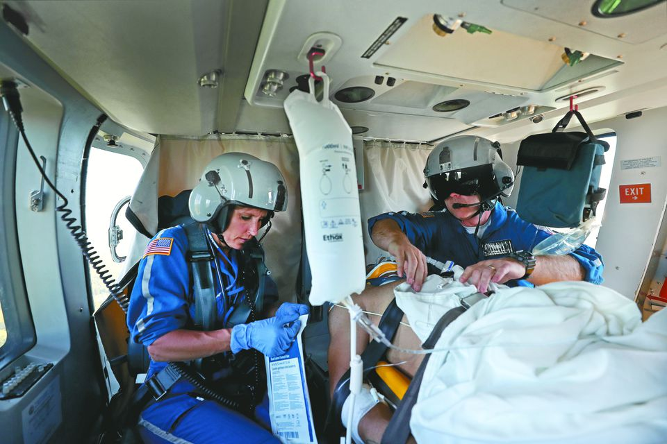 Chris Muszalski, left, and Scott McKinnon, right, treated a fall victim while heading back to Boston from Norfolk.