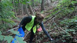 Boston University student Nina Wilson picked up trash along a trail on Saturday, Sept.18.
