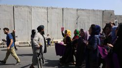 A Taliban fighter confronts a group of women demonstrating for women's rights in Kabul, Afghanistan, on Sept. 4.