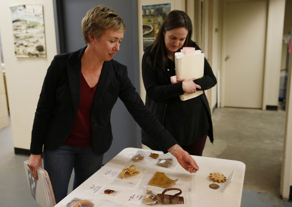 Dr. Sarah Kiley Schoff Anthropologist and President of Friends of Boston Archeology (left) and Sarah Keklak, Archeology Lab Manager, displayed a collection of artifacts that were uncovered in an excavation beside Faneuil Hall that show the links among the trans-Atlantic slave trade, Colonial Boston, and wealthy merchant Peter Faneuil.