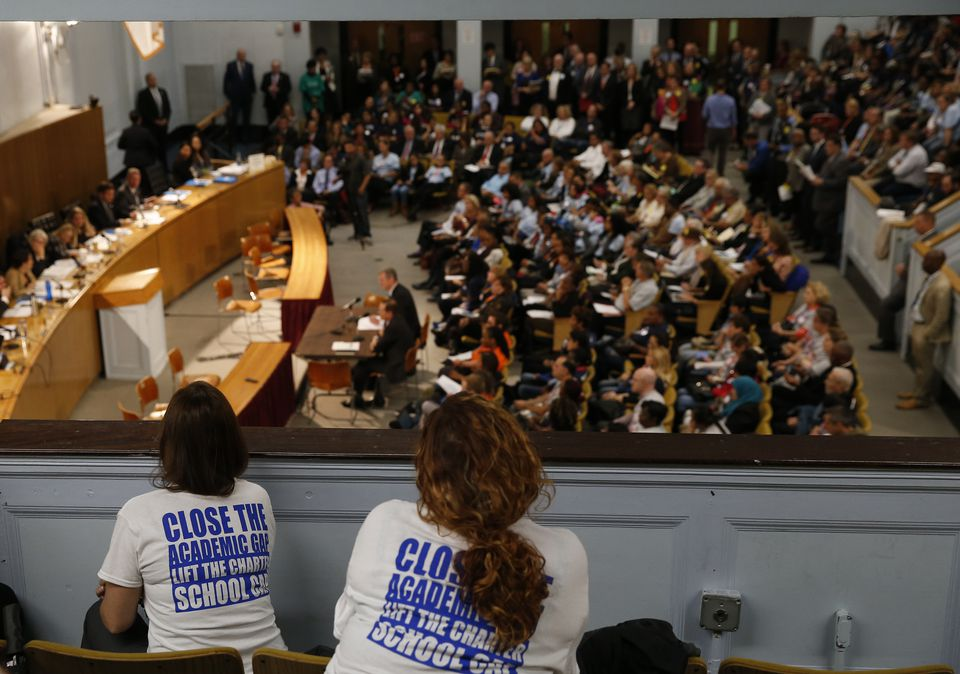 Supporters of lifting the charter school cap listened to Governor Charlie Baker testify at an education hearing on Beacon Hill last year.