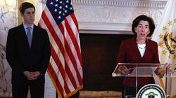 Brett Smiley, then the director of administration, looks on as then-governor Gina Raimondo holds a press conference.