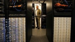 """Professor Tommaso Melodia, founding director of Northeastern's Institute for the Wireless Internet of Things, poses for a portrait at the """"Colosseum"""" facility in Burlington in July 2021."""