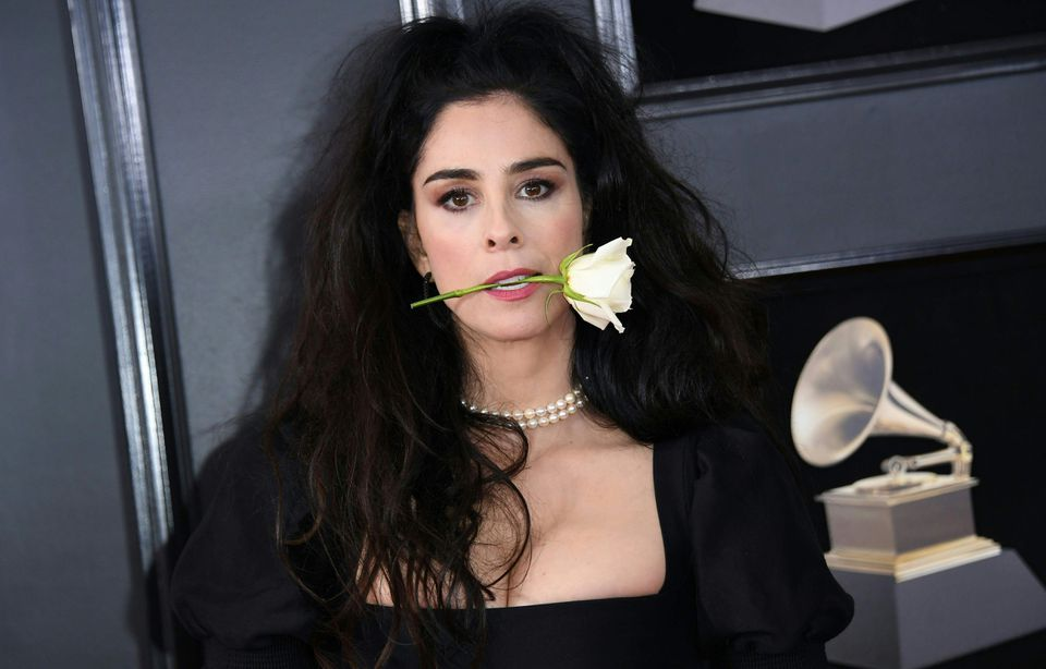 Sarah Silverman held a white rose in her mouth.