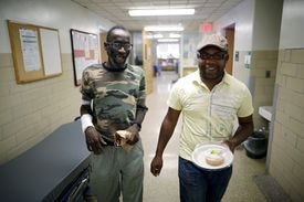 Jackson and his community health worker Gregory Jules leave the dialysis center en route to a birthday celebration.