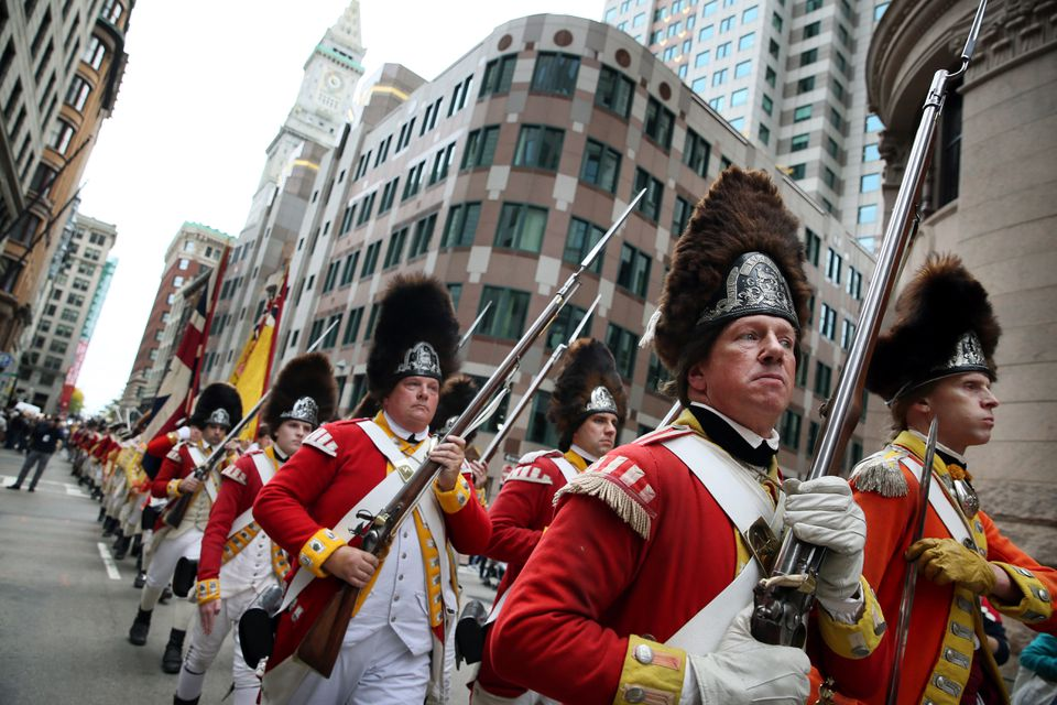 Reenactors Rob Lee (front, left) and Jeffery Meriwether (right) marched toward the Old State House.