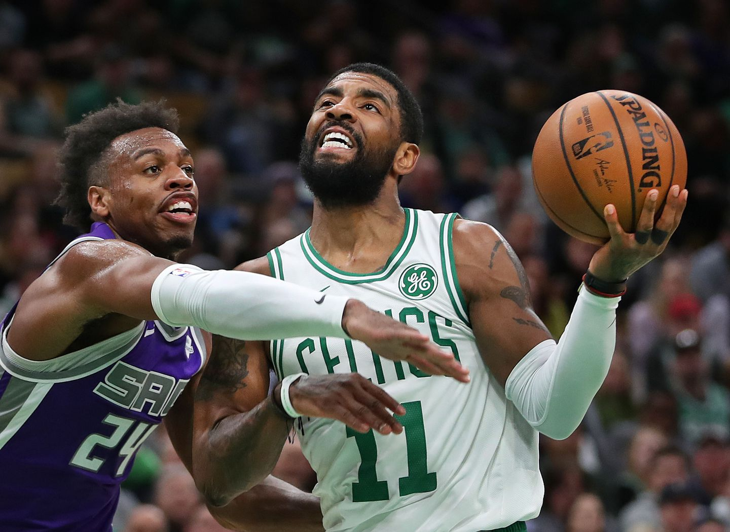 8eb6f6a37c81 Kyrie Irving drives past the Kings  Buddy Hield for a first-quarter basket.