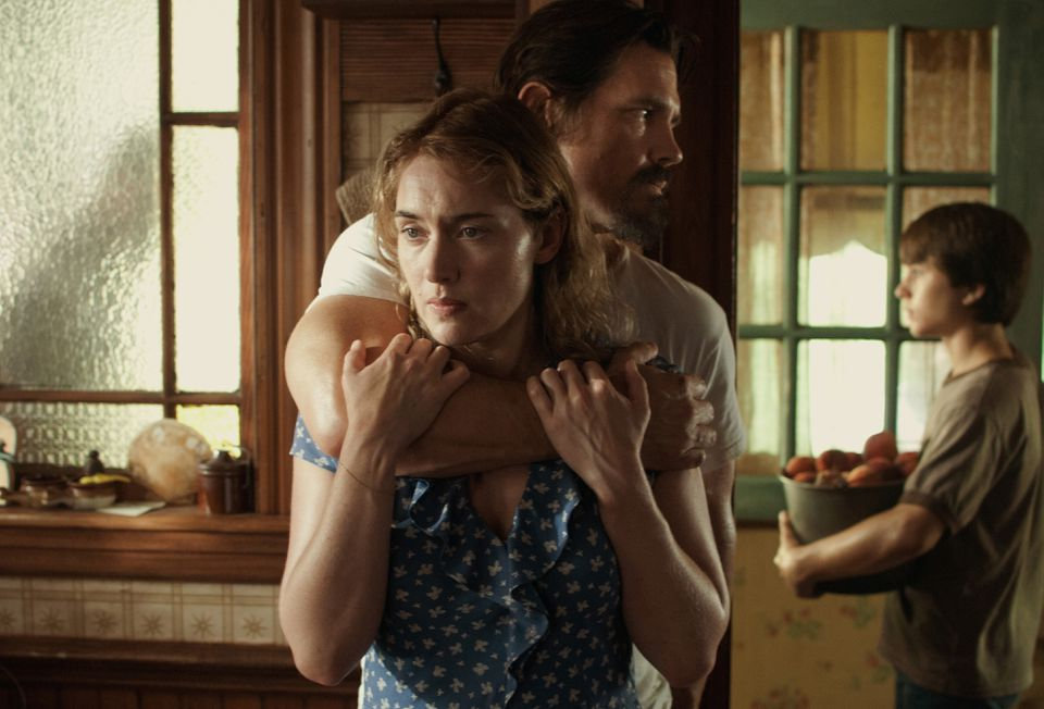 "Kate Winslet, Josh Brolin, and Gattlin Griffith in ""Labor Day."""