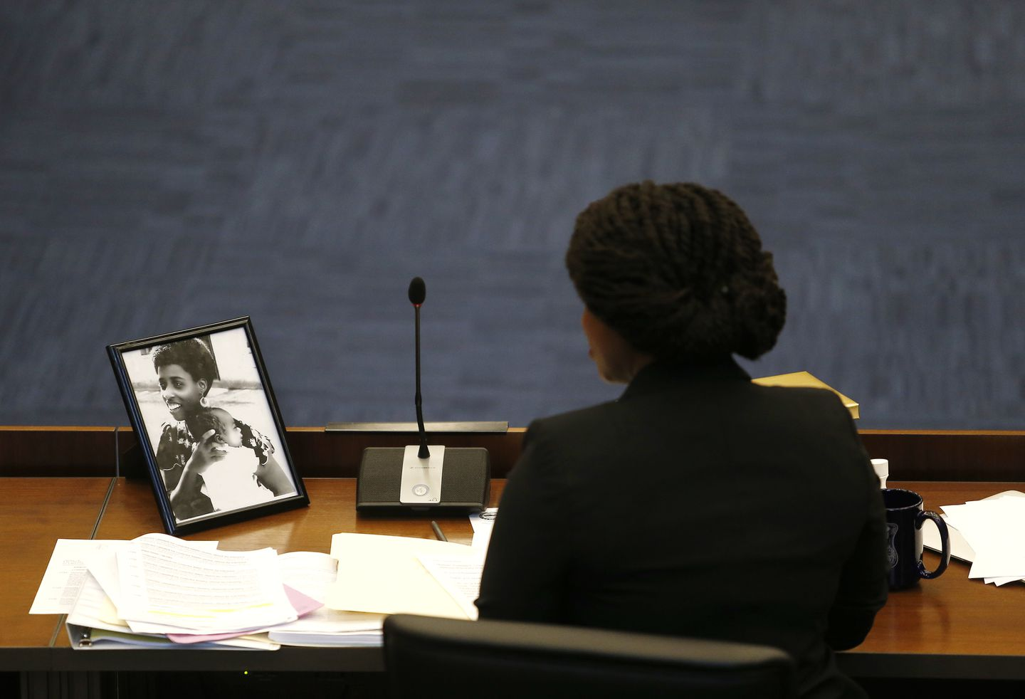 Ayanna Pressley kept a photograph of her mother at her seat as City Council colleagues wished her a fond thank you and farewell.