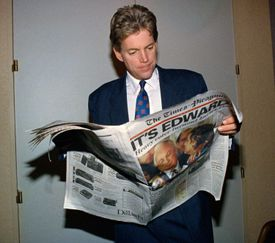 David Duke read about his defeat by Democrat Edwin Edwards in Louisiana's gubernatorial election in 1991.