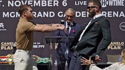 Canelo Álvarez (left) shoved Caleb Plant after they exchanged verbal barbs during a news conference.