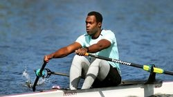 Aquil Abdullah, a 2004 Olympian, rows along the Charles River as he is being broadcast live to Hydrow rowers around the world for their rowing workouts.