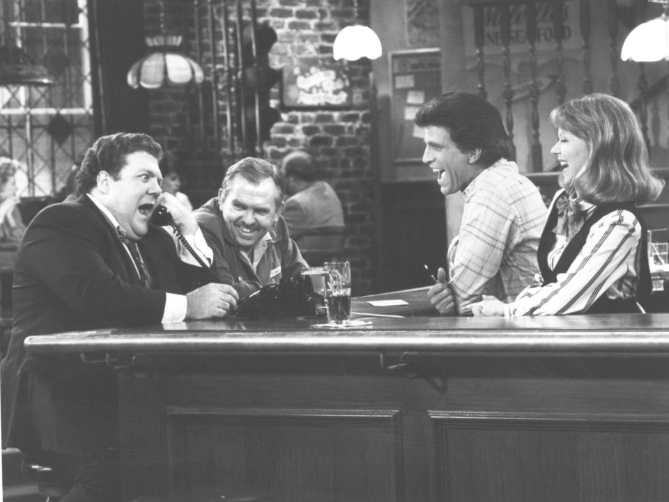 """When it comes to do-it-yourself, the author is more like Norm from """"Cheers"""" (far left, on phone)."""
