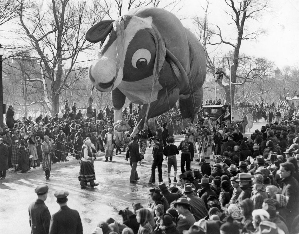"""A balloon entitled """"Ferdinand the Bull"""" floated along Beacon Street on the route of Santason parade in Boston on Thanksgiving Day, Nov. 24, 1938."""
