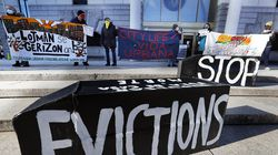 Demonstrators held signs in front of the Edward W. Brooke Courthouse in Boston in January.