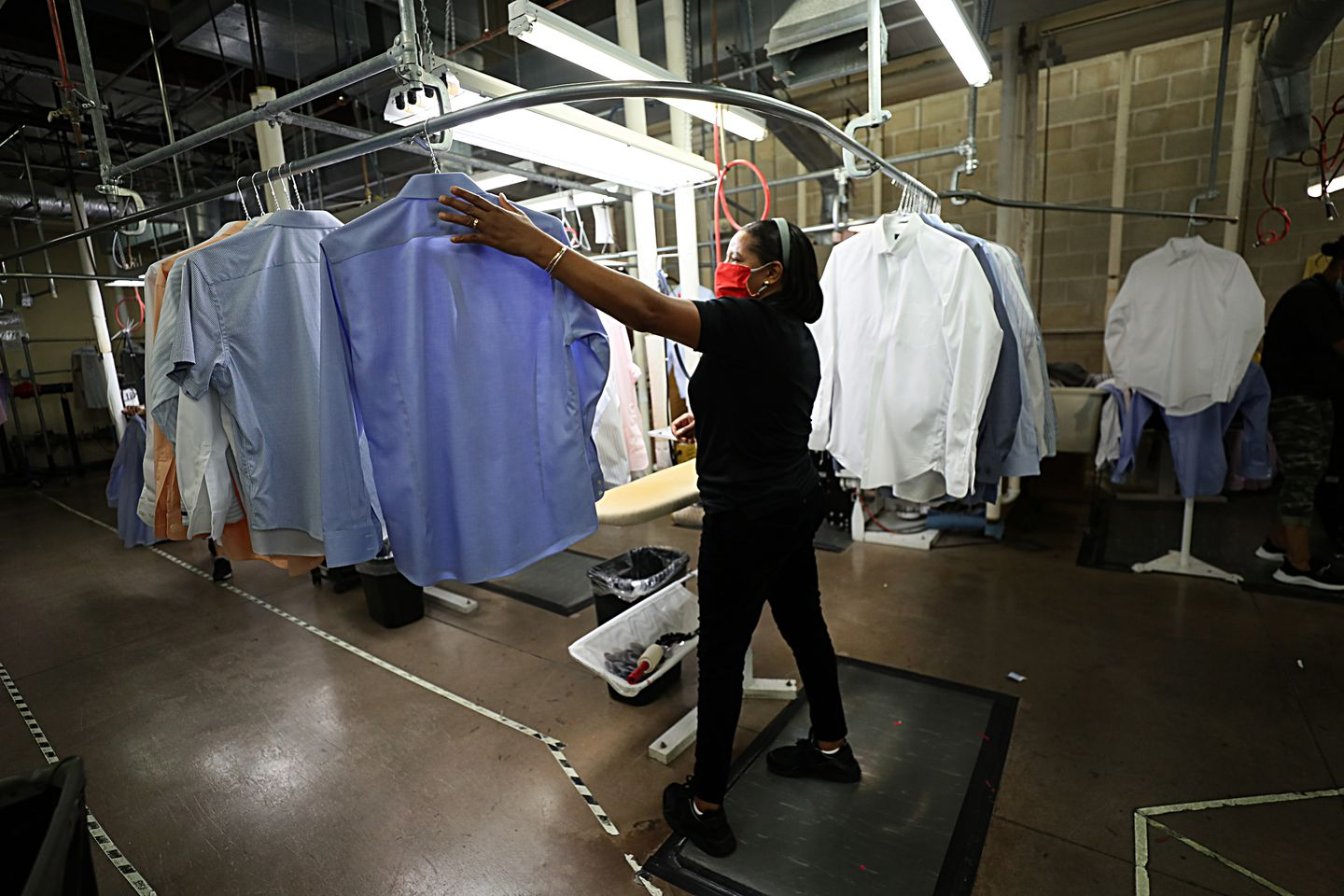 Maria Barbosa worked on men's shirts at Dependable Cleaners in Quincy on Friday.