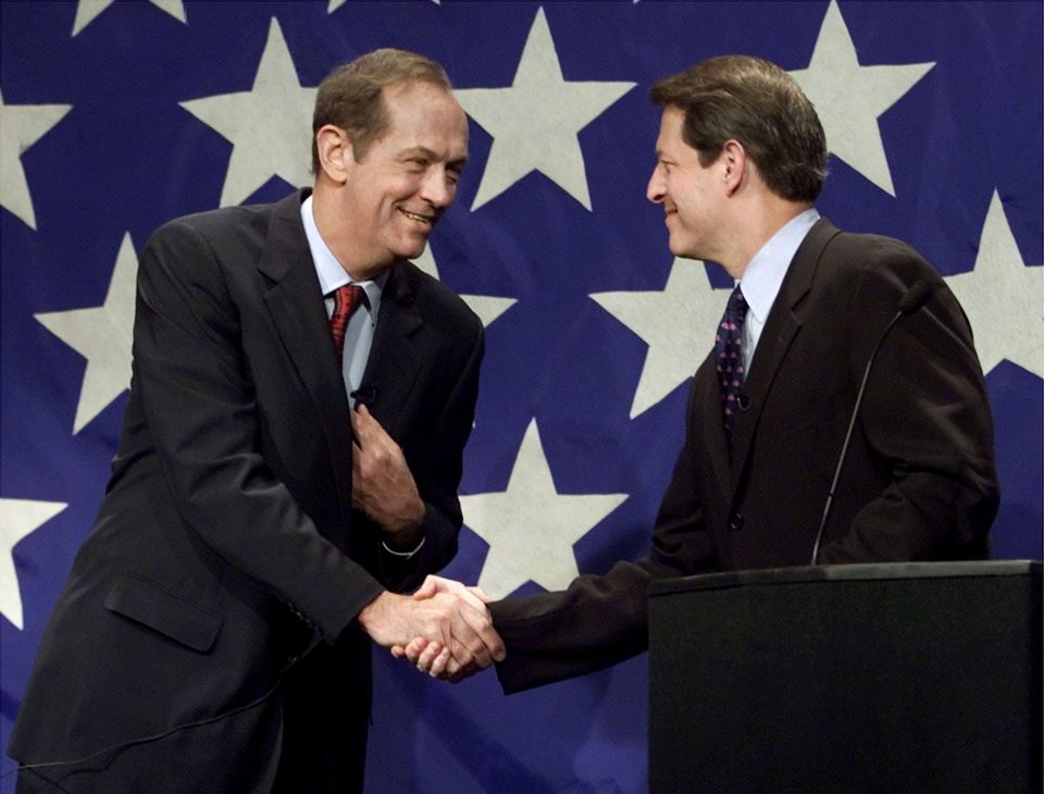 Bill Bradley (left) and Vice President Al Gore (right) shook hands after their debate at the University of New Hampshire in Durham, New Hampshire.