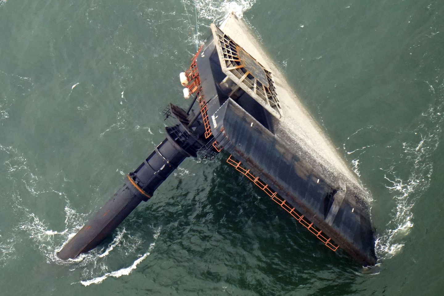 In this April 18, file photo, the capsized lift boat Seacor Power is seen seven miles off the coast of Louisiana in the Gulf of Mexico. The lift boat had lowered its legs and was trying to turn to face heavy winds when it flipped in the Gulf of Mexico off Louisiana last month, according to a preliminary federal report released last month.