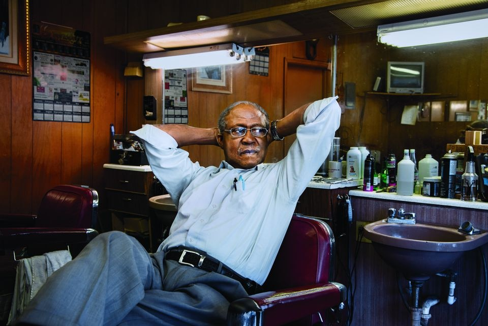 Barber Eugene Lyles relaxes in his Alabama shop.