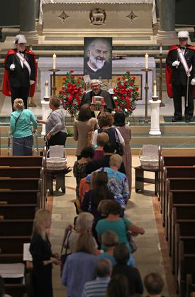 People lined up at Immaculate Conception Church in Lowell to venerate the reliquary containing the heart of St. Padre Pio. He is said to have bled from stigmata — holes in his hands, feet, and sides, as if he'd been nailed to a cross like Jesus — from 1918 until his death in 1968.