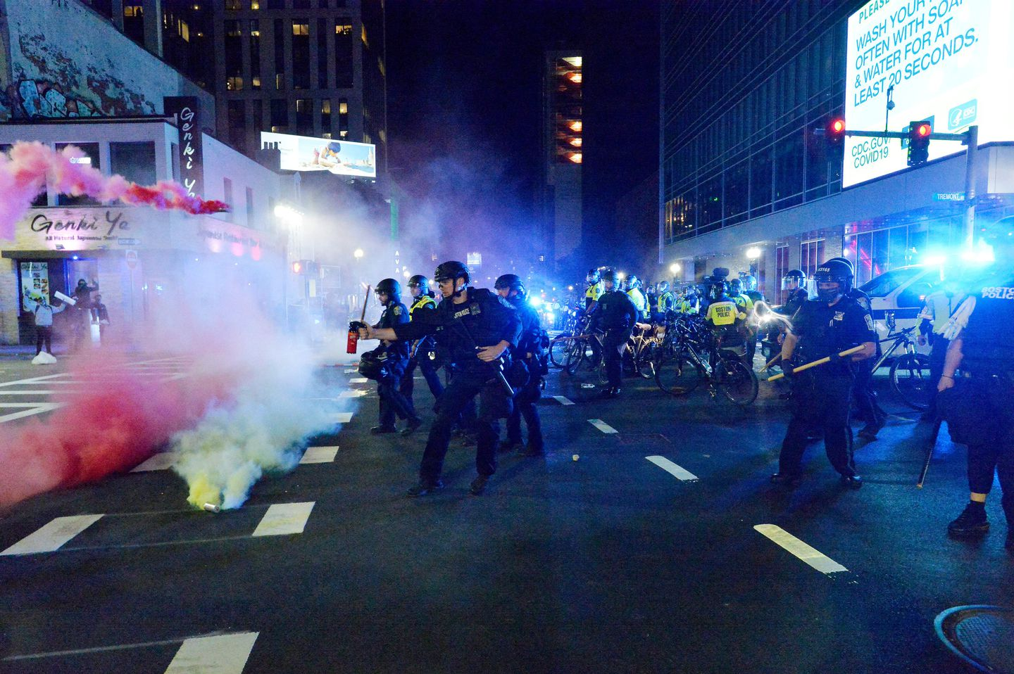 Smoke rose around police as they shot pepper spray during clashes with protesters near Downtown Crossing after a demonstration over the death of George Floyd on May 31.