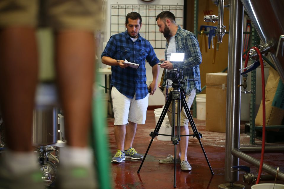 """Quaglia (left) and Uriot film at the Mayflower Brewing Co. in Plymouth for their upcoming """"American Brewed'' Web series."""