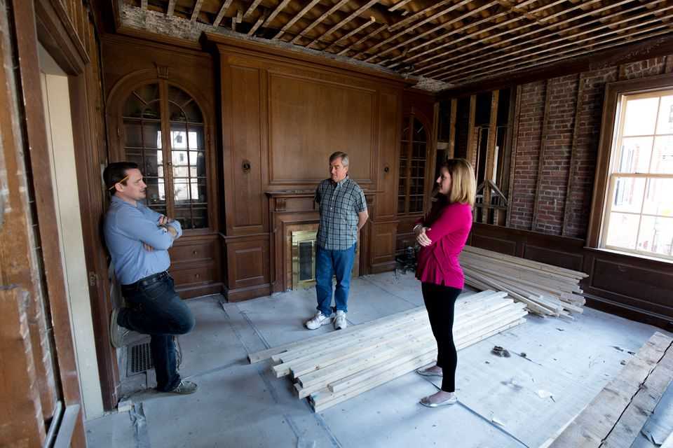 Builder Kevin Brett (left), Winchester Historical Commission member Jack LeMenager, and commission chair Heather von Mering tour a 1914 house being renovated at 7 Grove St. in Winchester.