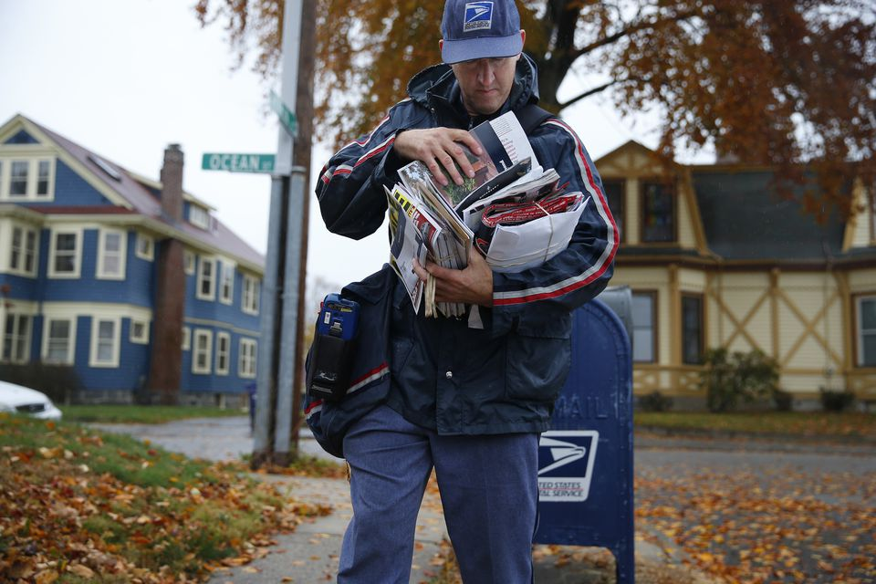 Richard Newayno, a carrier for 28 years, delivered mail along his route in Dorchester Tuesday.