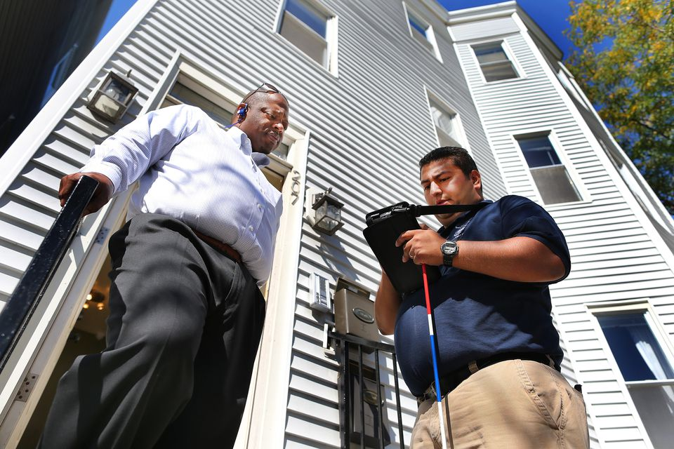 Landlord Allen Mathurin (left) had his apartment inspected by Marcio Fonseca Jr. of the city's Inspectional Services.