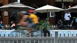 In Boston's North End, outdoor dining is everywhere on Hanover Street, including at Bricco. Barriers and fences are prominent as the road is narrowed due to the tables.
