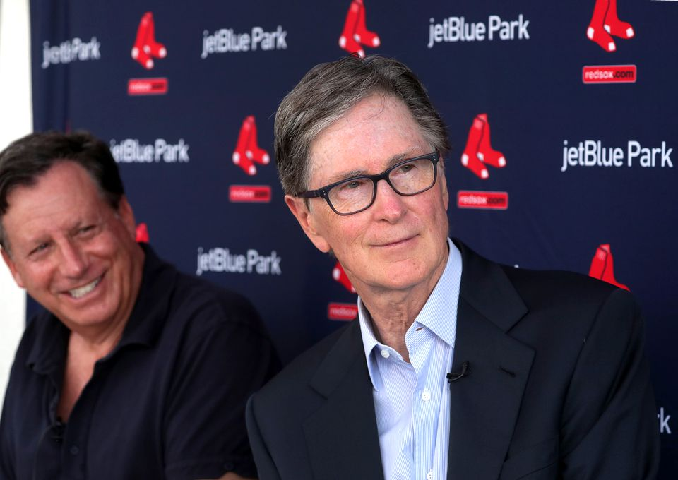 Tom Werner (left) and John Henry.