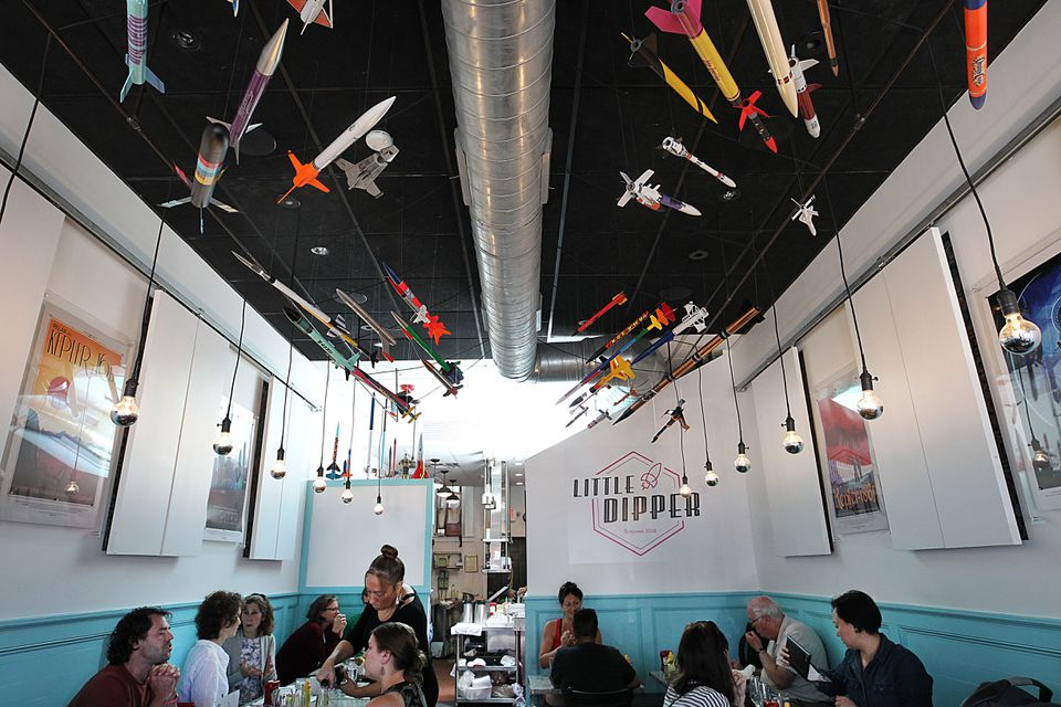 Model rockets hang from the ceiling at Little Dipper in Jamaica Plain.