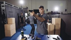 """Chad Stahelski, co-director of the film, """"John Wick,"""" demonstrated proper gun handling during a training session at 87Eleven Action Design in Inglewood, Calif., in 2014. Guns used in making movies are sometimes real weapons that can fire either bullets or blanks, which are gunpowder charges that produce a flash and a bang but no deadly projectile."""