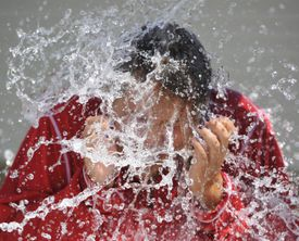 A teenager in Pennsylvania reacted to the cold water dumped on her head for the Ice Bucket Challenge.