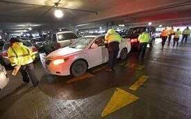 Valets help ease the school vacation week parking crunch at Logan Airport in February 2014.